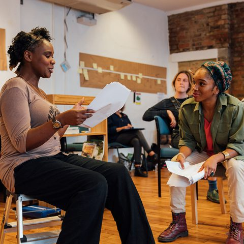 Cherrelle Skeete and Nicola Alexis in rehearsals on chairs