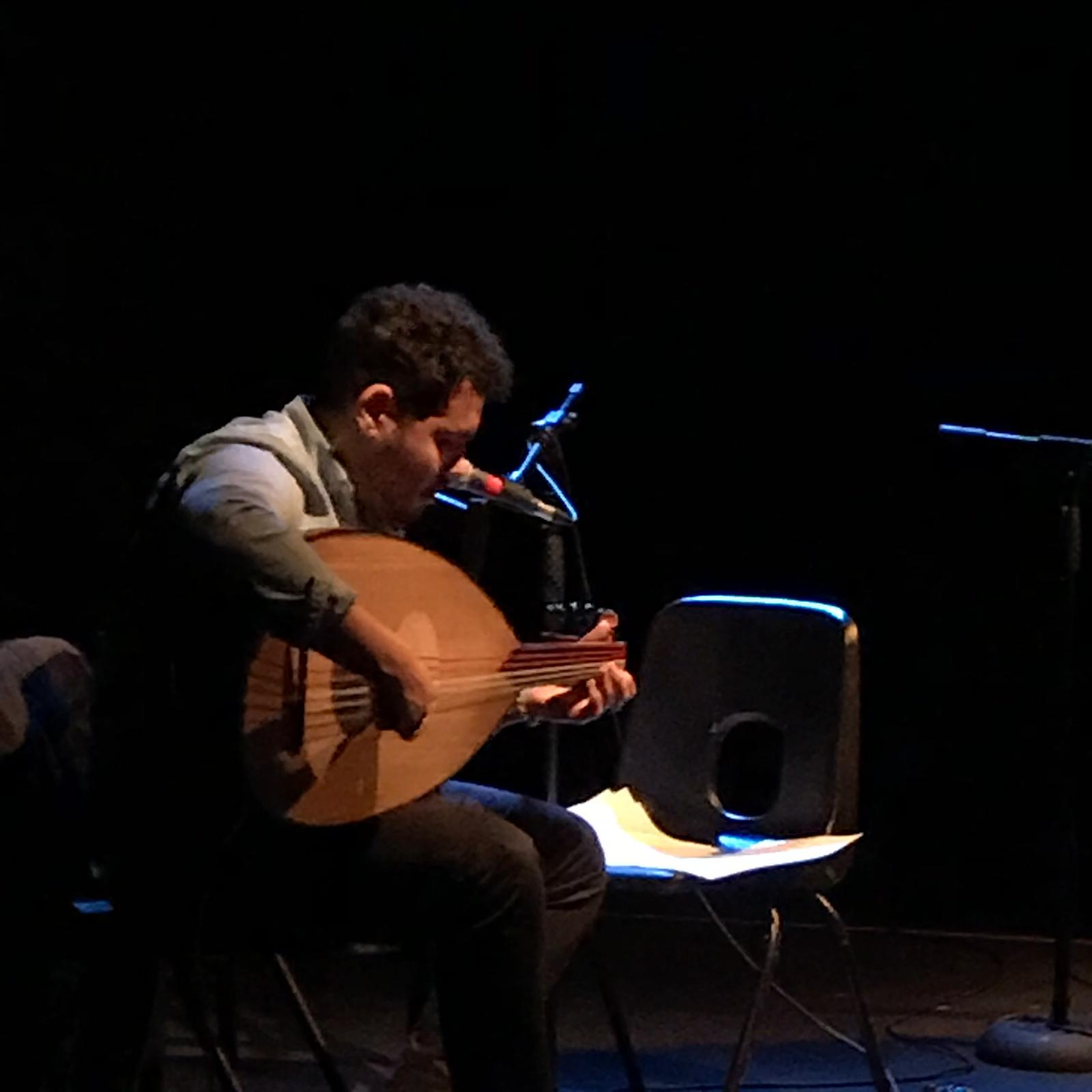 Kareem Samara plays the oud on stage